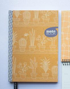 opschrijfboek oranje met print hard kaft