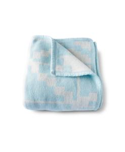 pastle blauwe deken geweven met print